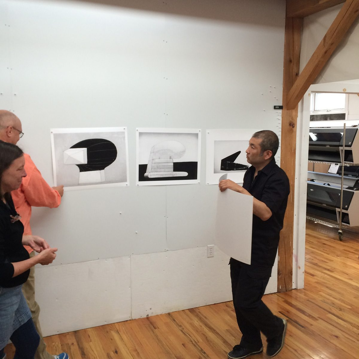 Hiroyuki Hamada putting up some his prints after the Vermont workshop. Horoyuki came to see if Piezography could work with his process and he ended up buying a system!